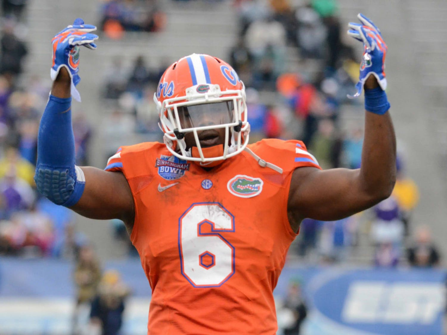 Dante Fowler Jr hypes up the crowd during Florida's 28-20 win in the Birmingham Bowl against East Carolina on Jan. 3 at Legion Field.