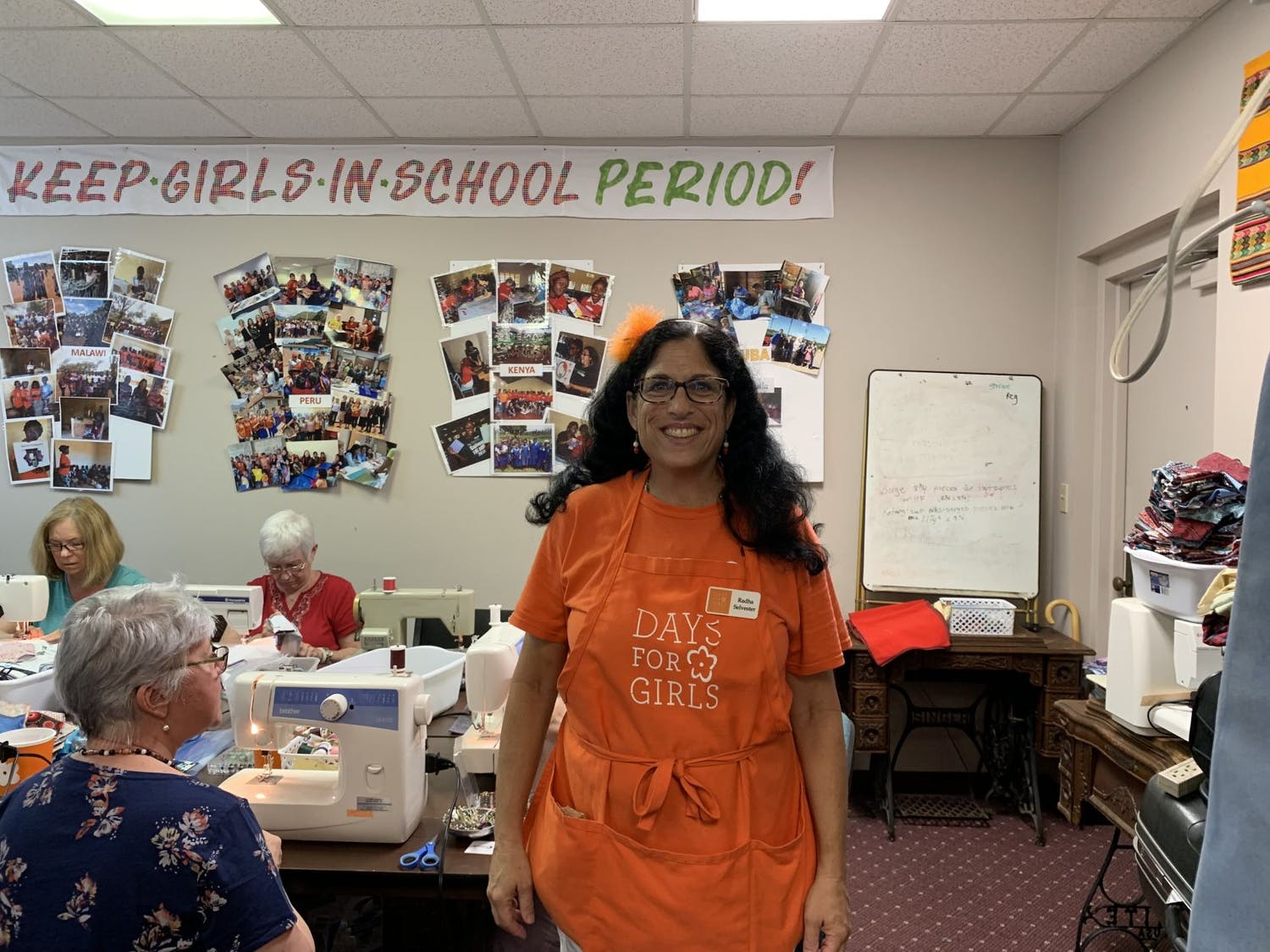 Radha Selvester, chapter chair of Days for Girls Alachua, oversees the order of operations of the Memorial Day kit assembling event.