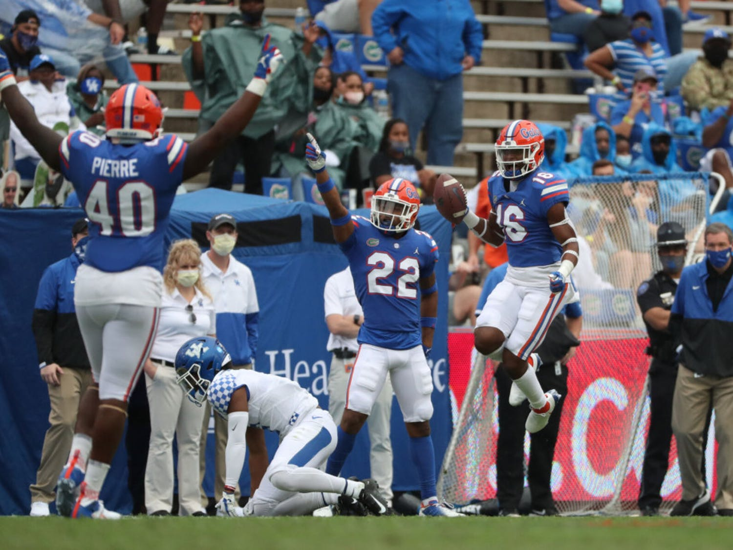 Tre'Vez Johnson (16), Jesiah Pierre (40) and Rashad Torrence II (22) celebrate in the Gators game against Kentucky in The Swamp on Nov. 28.