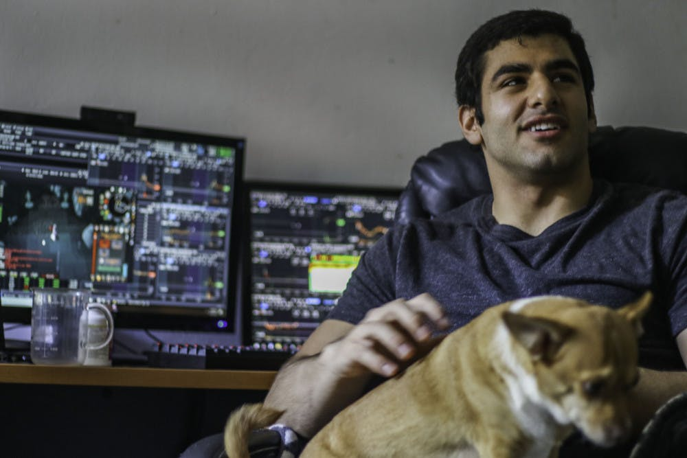 "<p><span>Jamal Waked, a 23-year-old UF alumnus, holds his dog Sonny Thursday while being interviewed in his apartment at College Park, 303 NW 17th St. Waked made living alone a priority when he was looking for an apartment. ""I need my own space. I need to do my own thing,"" he said.</span></p>"