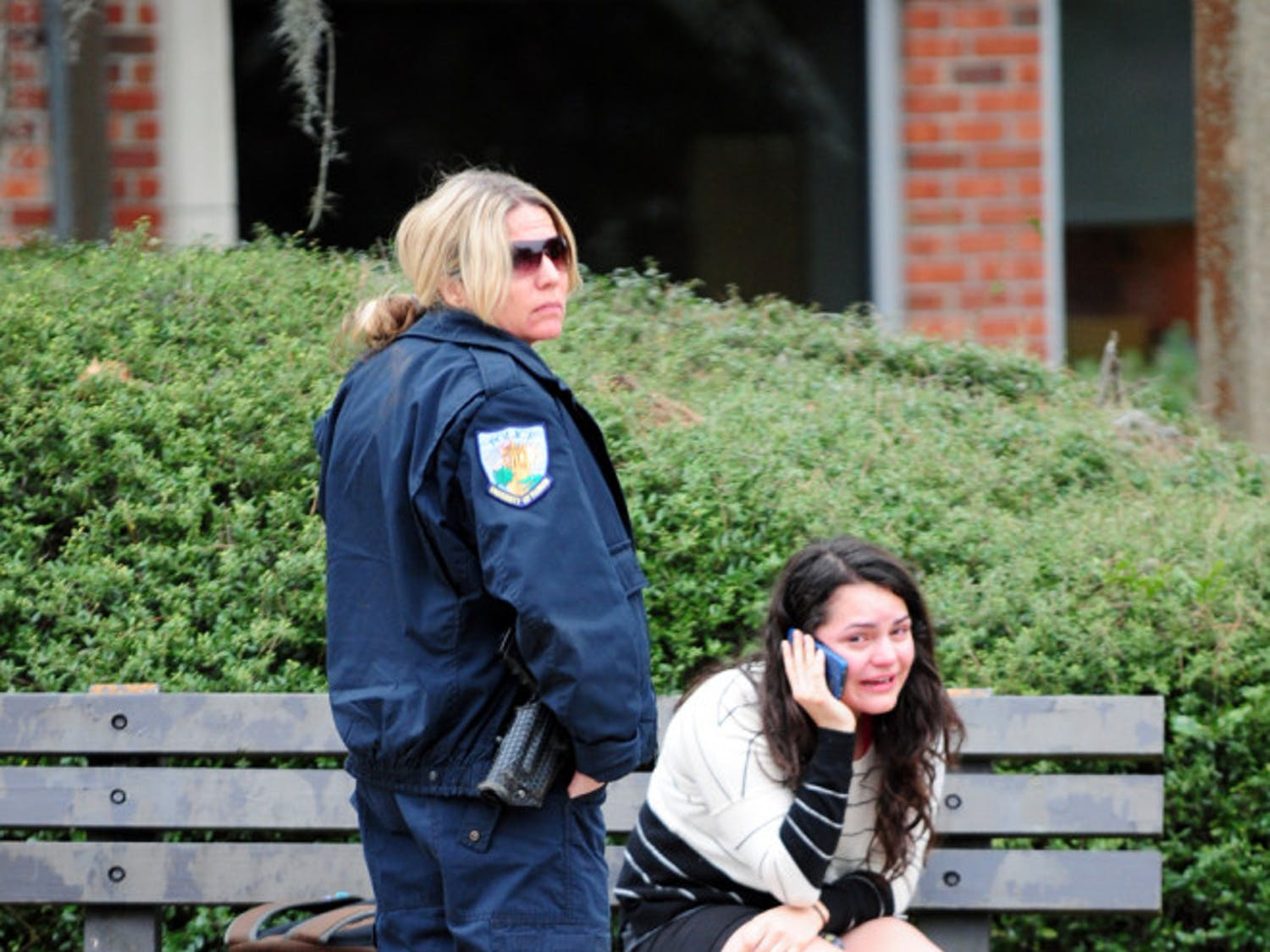 Melanie Cabezas, a 21-year-old chemical engineering senior, talks on the phone Thursday evening after getting hit by a Route 38 RTS bus near the Hub.