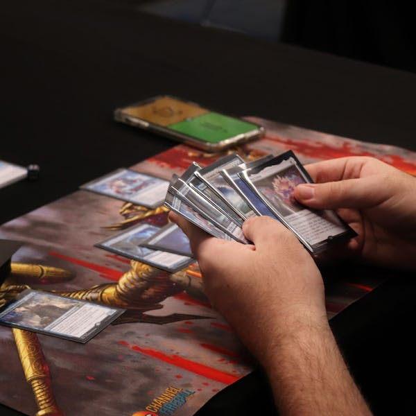 "A picture of a student in Magic the Gatorling playing ""Magic: The Gathering"""