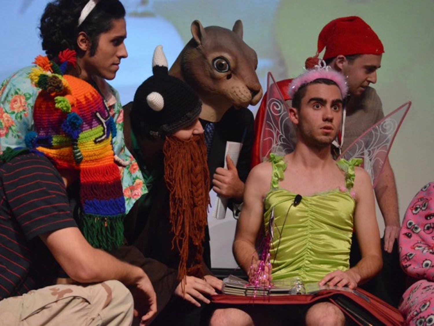 Tyler Chatam, a 19-year-old telecommunication freshman, acts as a sleep fairy in the Sandman sketch during Theatre Strike Force's sketch comedy show aMOCKalypse in the Rion Ballroom on Monday night.