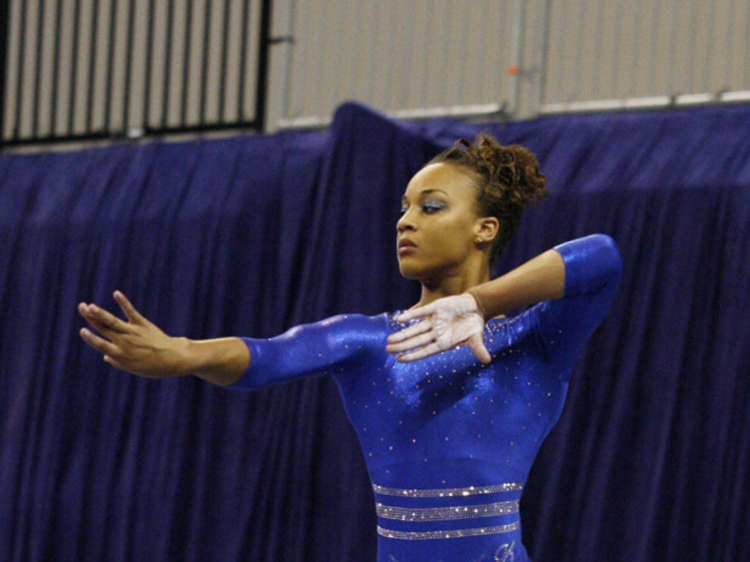 Junior Kytra Hunter performs her beam routine in a dual meet against Ball State on Jan. 4, 2013, in the O'Connell Center. Hunter claimed first place in all-around and floor in the Gators' season-opening meet against UCLA in the Pauley Pavilion in Los Angeles on Saturday.