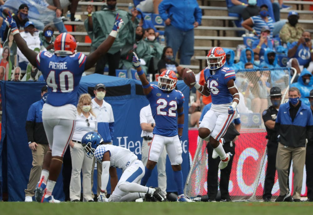 """<p dir=""""ltr"""">Tre'Vez Johnson (16), Jesiah Pierre (40) and Rashad Torrence II (22) celebrate in the Gators game against Kentucky in The Swamp on Nov. 28.</p>"""