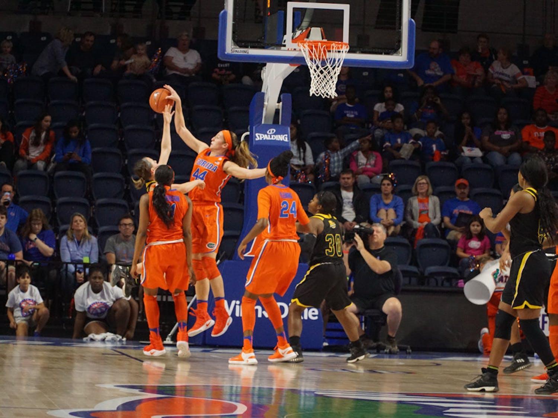 Haley Lorenzen blocks a shot during Florida's win against Southeastern Louisiana on Dec. 28, 2016 in the Exactech Arena.