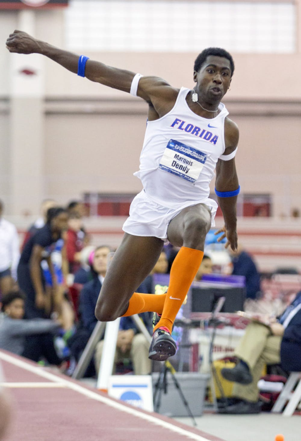 <p>Marquis Dendy competes in the triple jump during the 2015 NCAA Indoor Championships on March 14 in Fayetteville, Arkansas.</p>