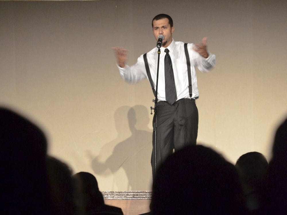 """<p class=""""p1"""">A spoken word artist performs during UF's Hispanic Heritage Month Opening Ceremony on Wednesday in the Reitz Union Grand Ballroom.</p>"""
