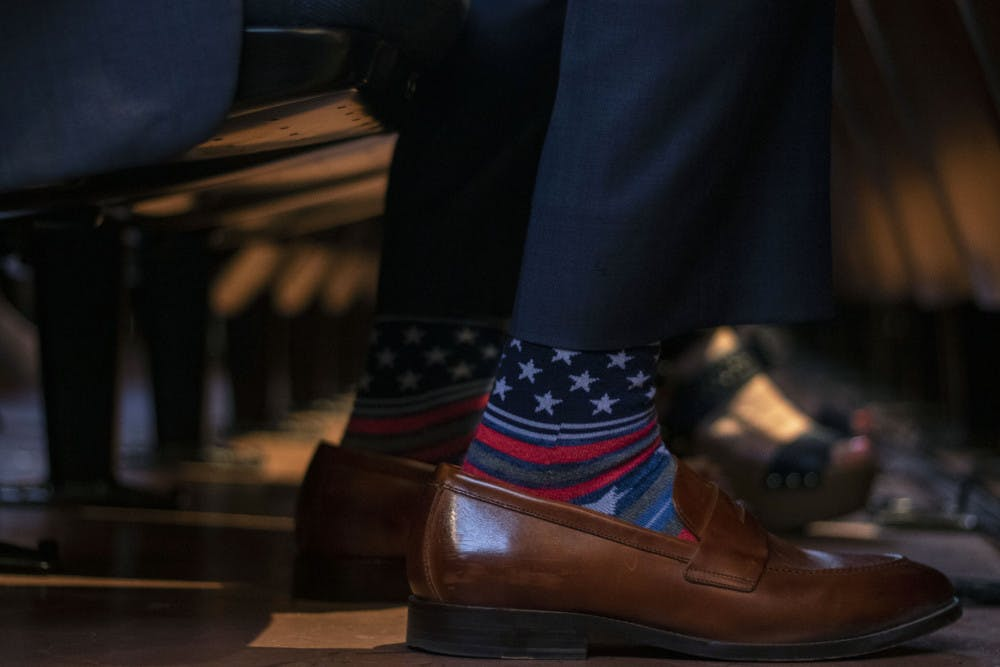 "<p dir=""ltr"">Senator Keith Perry wears socks with stars and stripes Thursday while waiting for Donald Trump Jr. to speak.</p>"