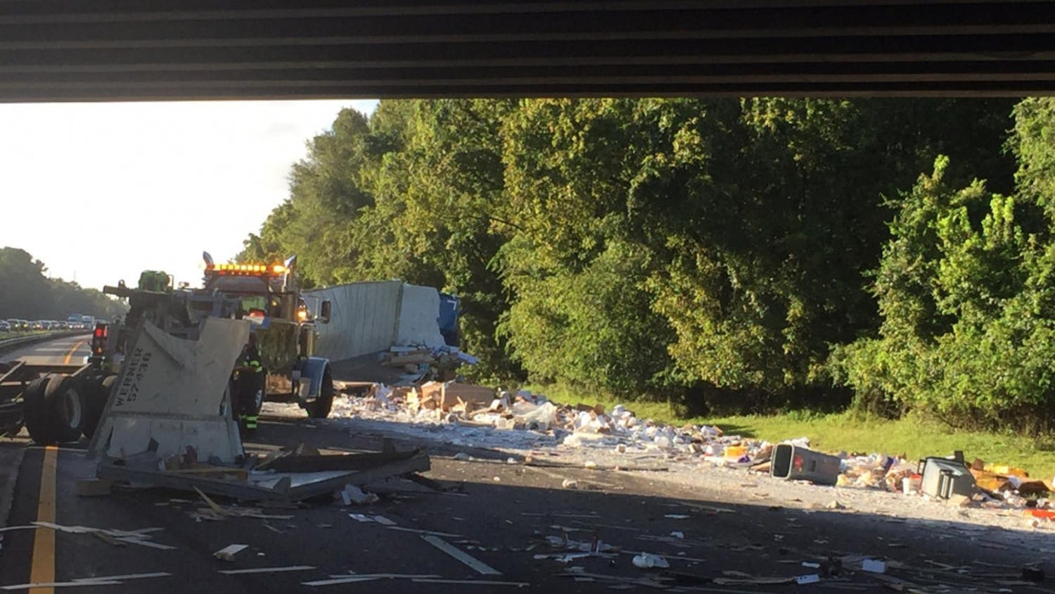 Construction materials spilled over all three Southbound lanes on Interstate 75 after a semi tipped over Friday morning.