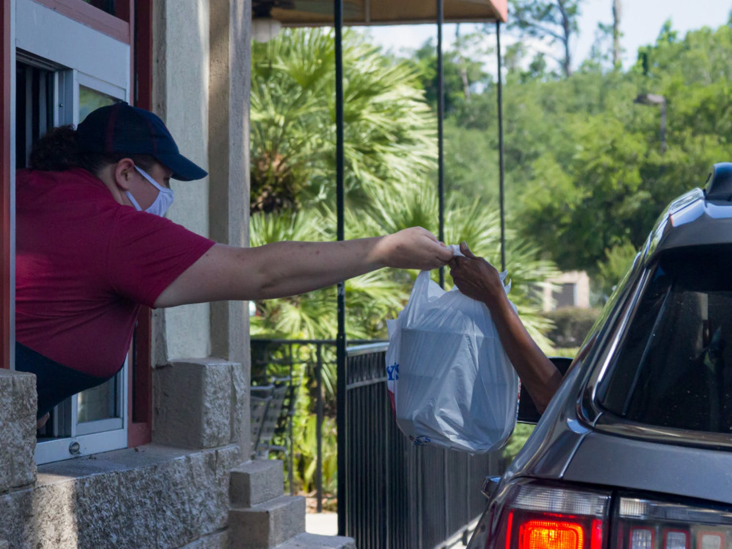 A global pandemic does not stop fast-food businesses. As drive-thrus continue to overflow with customers, workers continue to provide.