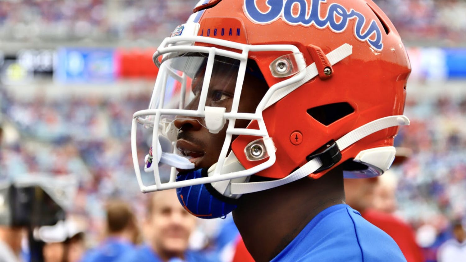 A close-up photo of a Florida player wearing his helmet