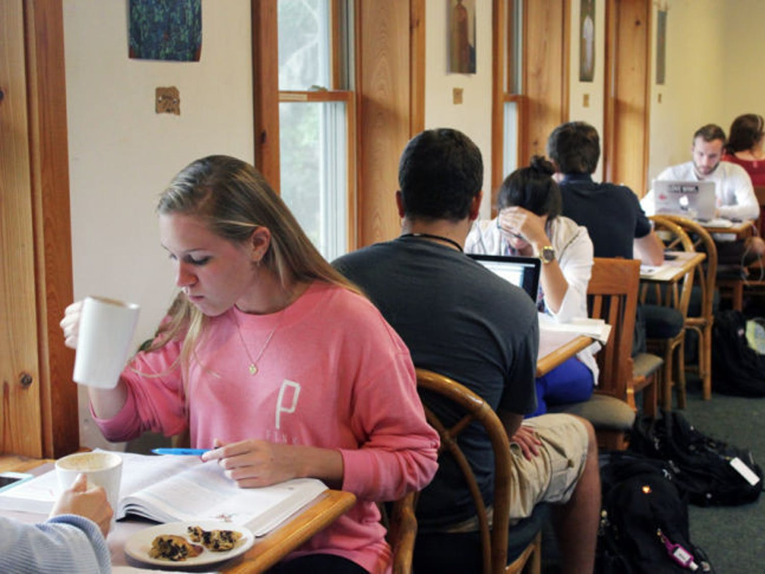 Students drink coffee and study at Pascal's Coffeehouse, two blocks north of campus on Northwest 16th Street.