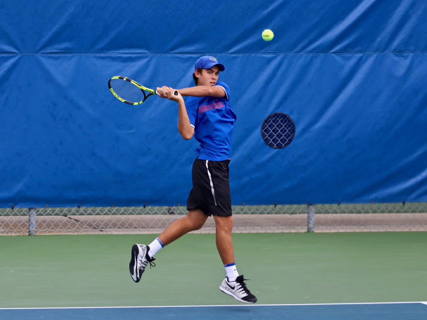 Sophomore Greysen Cacciatore split his two singles matches Thursday, failing to qualify.
