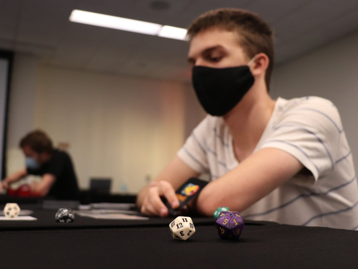 Ryan Feldbush, 19, a UF computer science sophomore, is seen playing 'Magic: The Gathering' at the Reitz Student Union on Wednesday, Sept. 30, 2020. Feldbush said he's played the game for six years now.