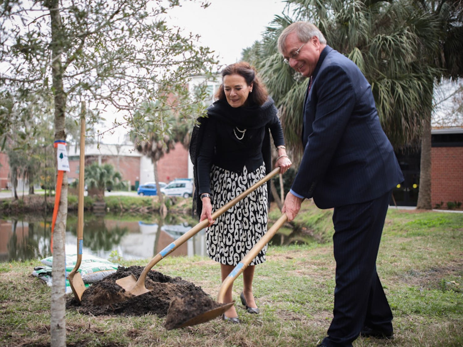 "UF President Kent Fuchs and Wageningen University and Research Executive Board President Louise Fresco planted a 9-foot live oak tree Thursday for Florida Arbor Day. This is part of an initiative to plant 100 ""UniversiTREEs"" across the world."