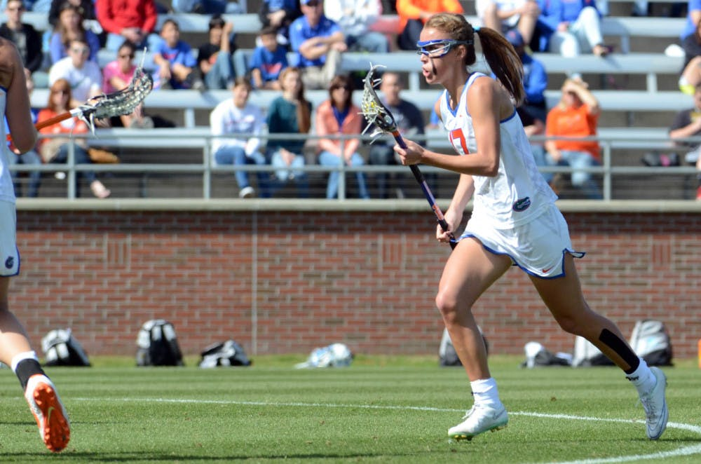 <p>Sophomore midfielder Mollie Stevens runs down the field during UF's 17-11 loss to UNC on Saturday at Donald R. Dizney Stadium.</p>