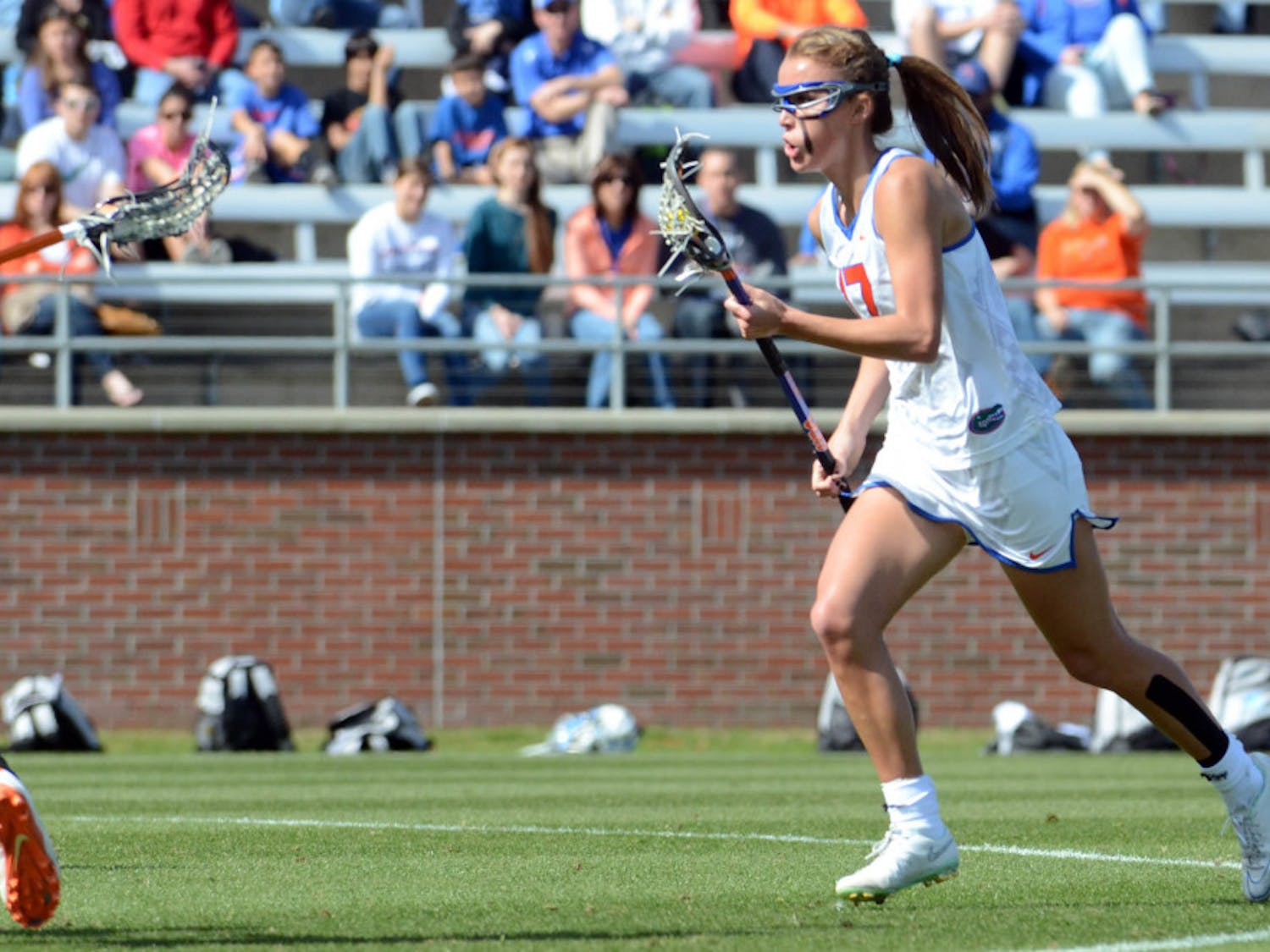 Sophomore midfielder Mollie Stevens runs down the field during UF's 17-11 loss to UNC on Saturday at Donald R. Dizney Stadium.
