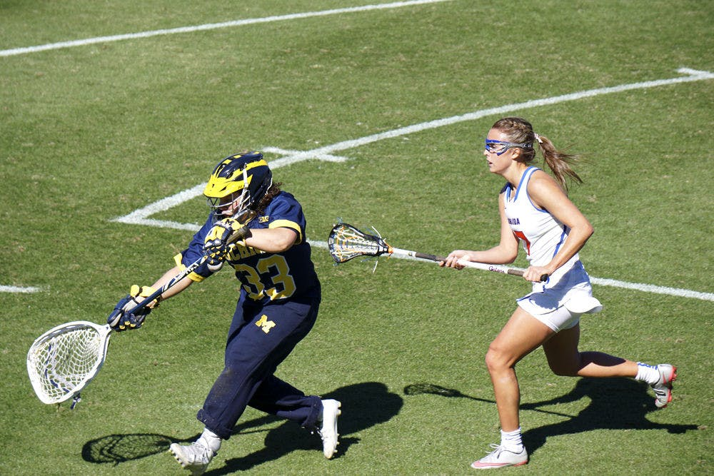 <p>UF's Mollie Stevens attempts to make a play on the ball during Florida's 12-11 win over Michigan on Feb. 13, 2016, at Donald R. Dizney Stadium.&nbsp;</p>