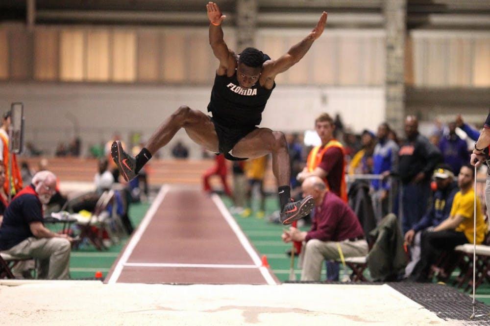 <p>UF freshman Grant Holloway jumps at the Hokie Invitational men's long jump final on Jan. 21, 2017.</p>