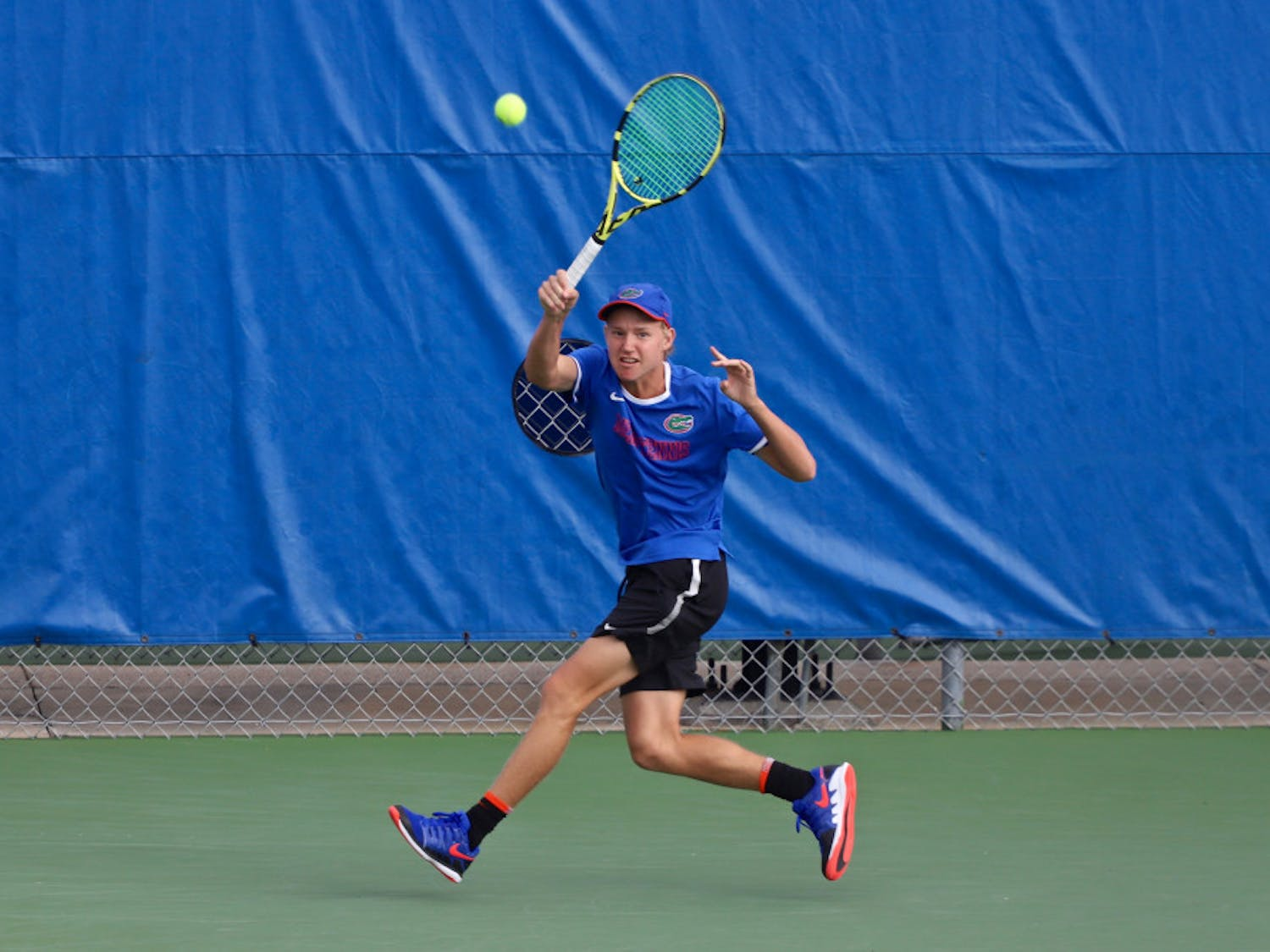 Lukas Greif swings at a tennis ball on the fourth day of the ITA Tournament in Gainesville last season. He and Will Grant teamed up for a doubles win in South Carolina Friday.