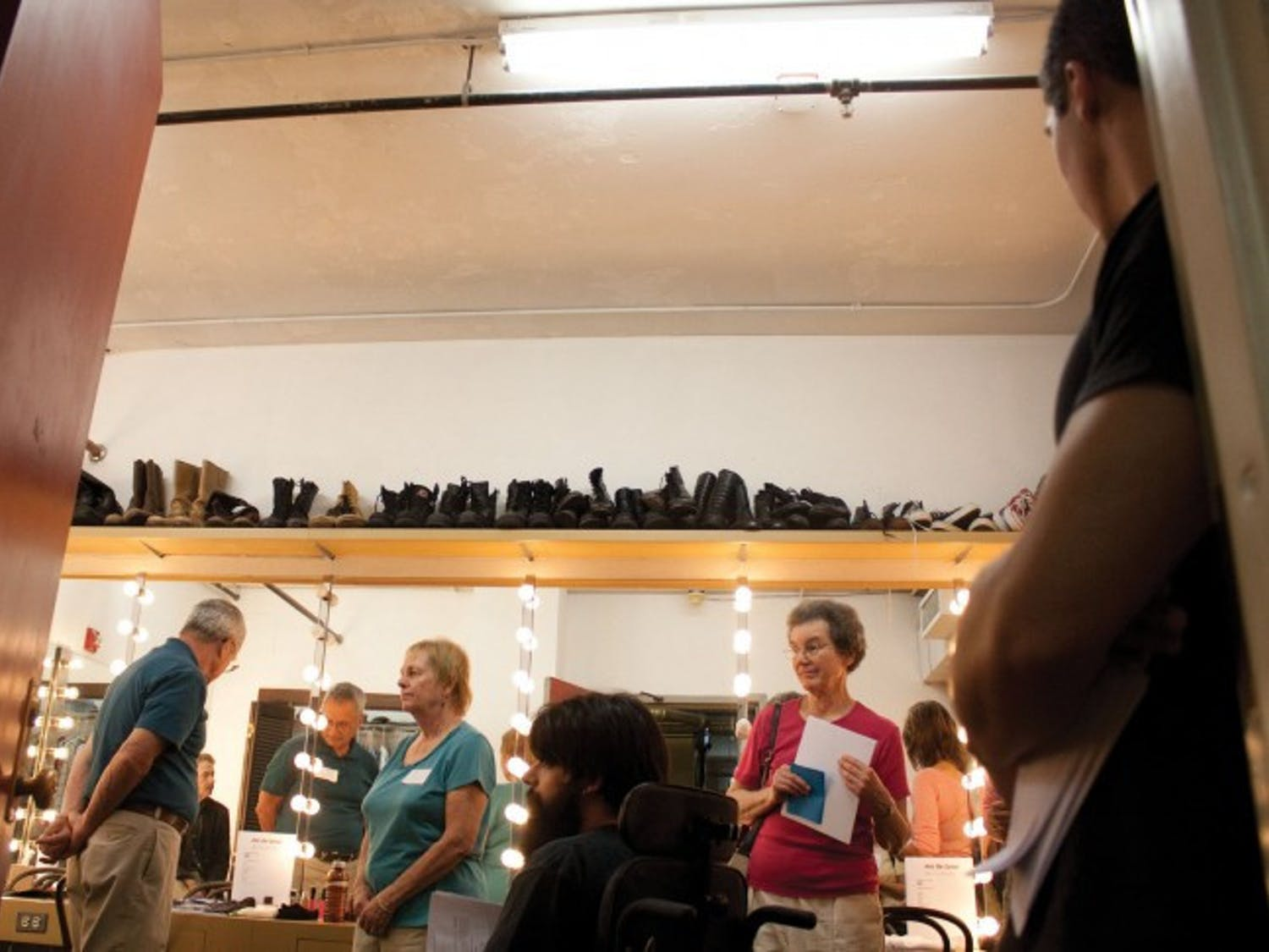 Visitors look around one of the backstage dressing rooms on the behind-the-scenes tour of the Hippodrome Theatre in downtown Gainesville on Friday.