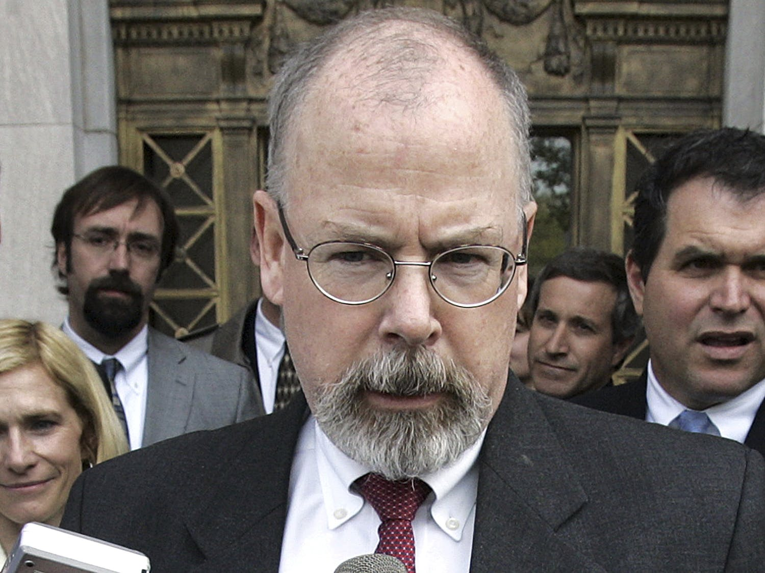 FILE - In this April 25, 2006, file photo, John Durham speaks to reporters on the steps of U.S. District Court in New Haven, Conn. Durham, Connecticut's U.S. attorney, is leading the investigation into the origins of the Russia probe. He is no stranger to high-profile, highly scrutinized investigations. (AP Photo/Bob Child, File)