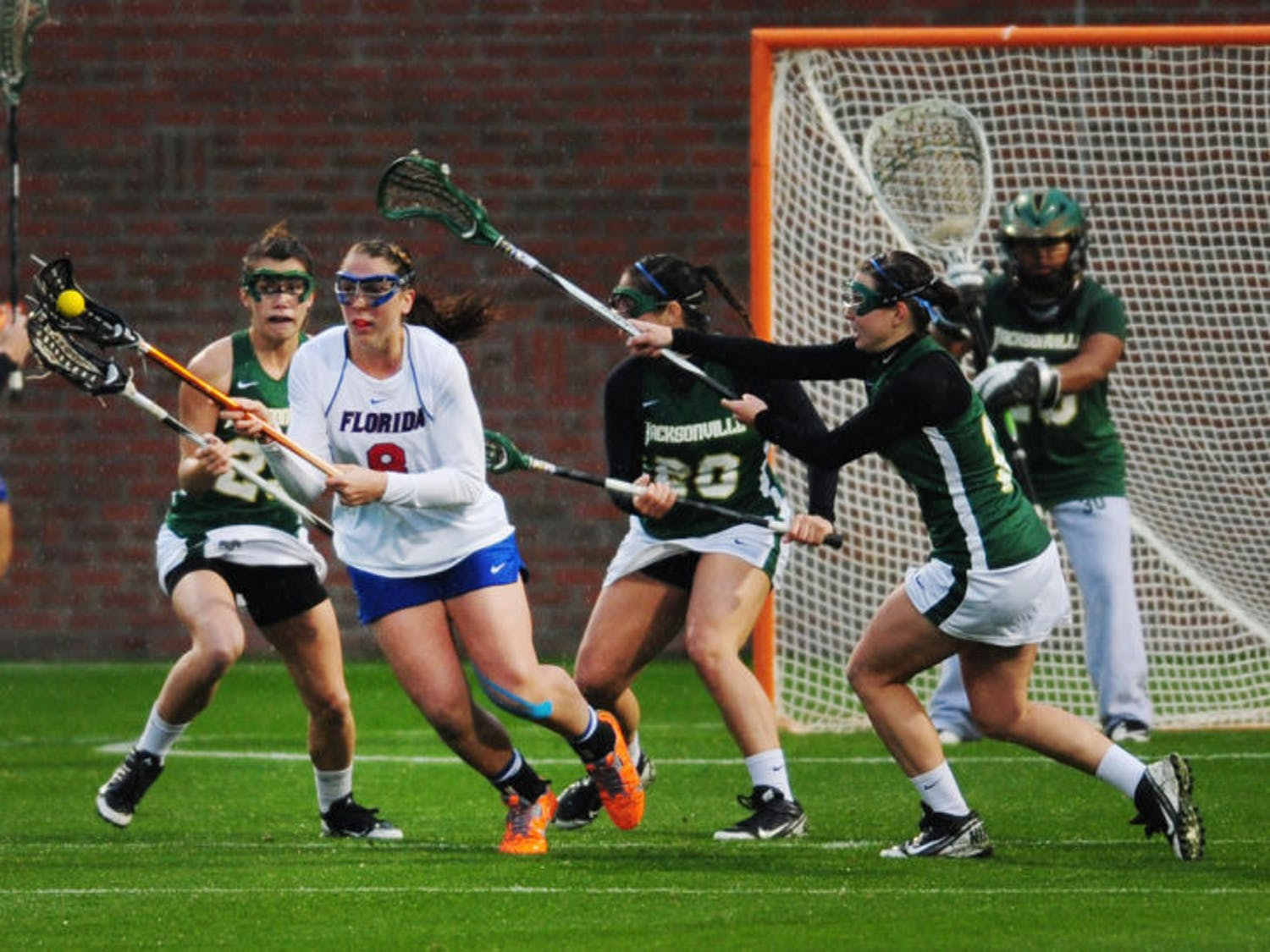 Shannon Gilroy breaks away from a group of defenders during Florida's 21-5 win against Jacksonville on Feb. 12 at Donald R. Dizney Stadium.