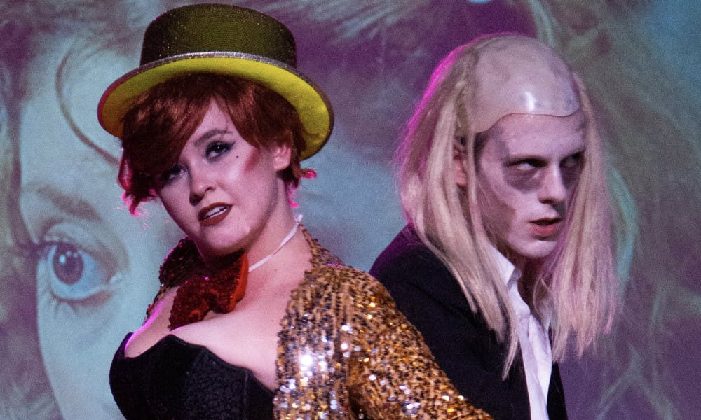 "<p><span>Garret Pogue (left) as Columbia and Devin Huchingson (right) as Riff Raff in last year's ""The Rocky Horror Picture Show"" performance at High Dive.</span></p>"