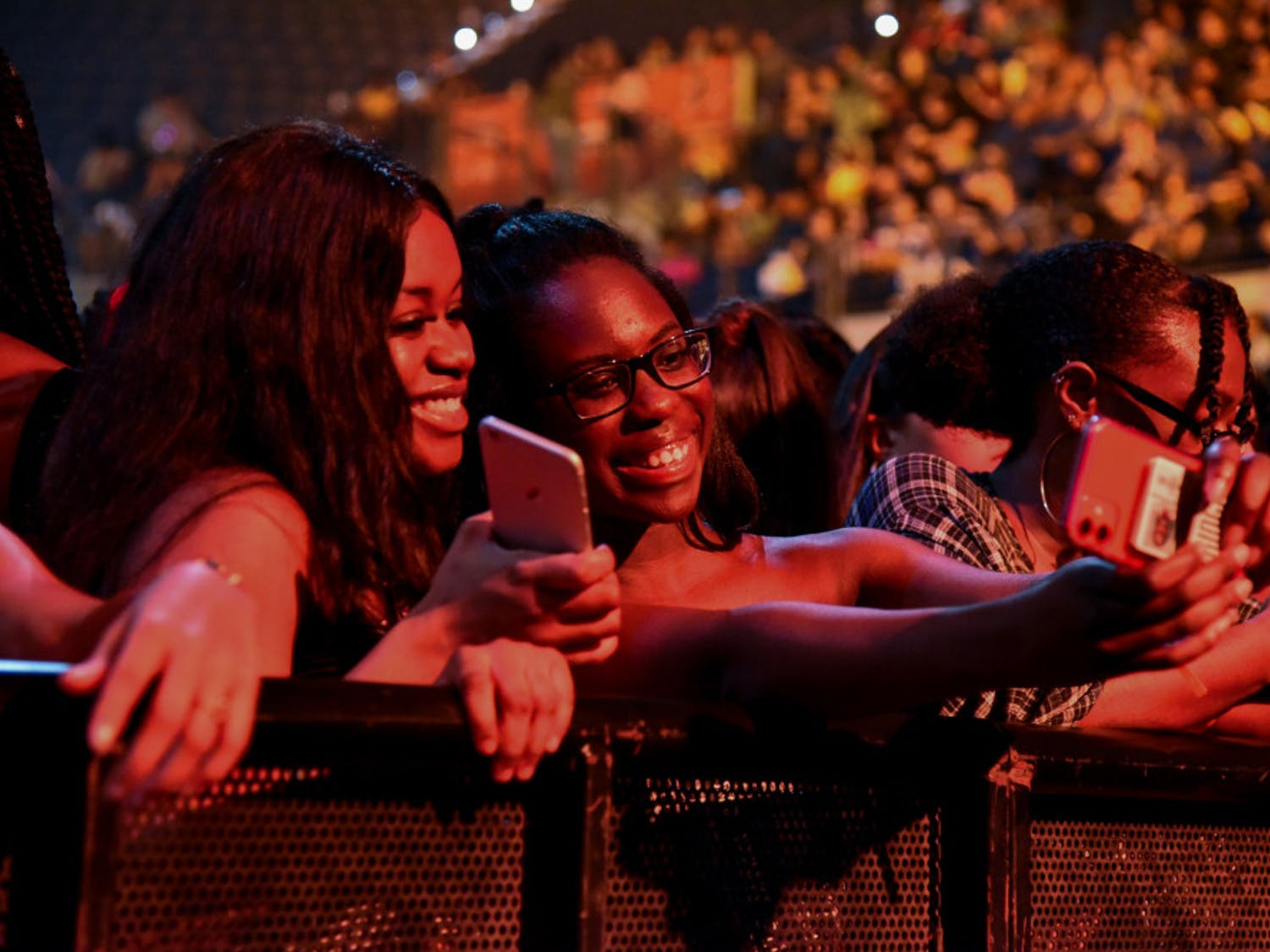 Tatiana Delaleu, a 20-year-old UF microbiology sophomore, takes a selfie with her friend, Jemima Jean Charles, a 20-year-old UF health science sophomore, while they wait for Tory Lanez to perform at the O'Connell Center Monday night.