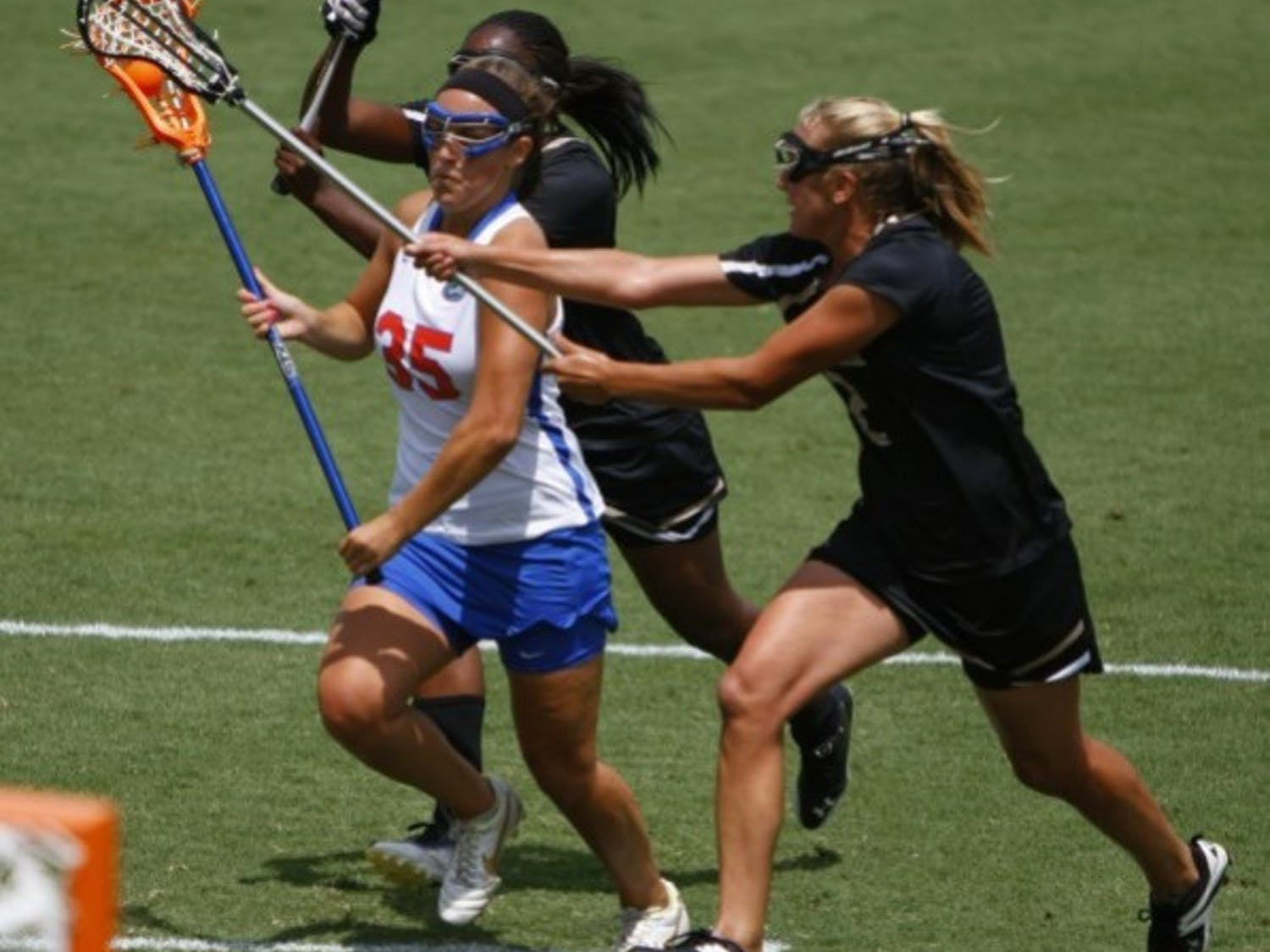 Florida attacker Gabi Wiegand drives between two defenders in a game against Vanderbilt on April 14. Wiegand scored the game-winning goal in Florida's 8-7 win over Northwestern on Saturday.