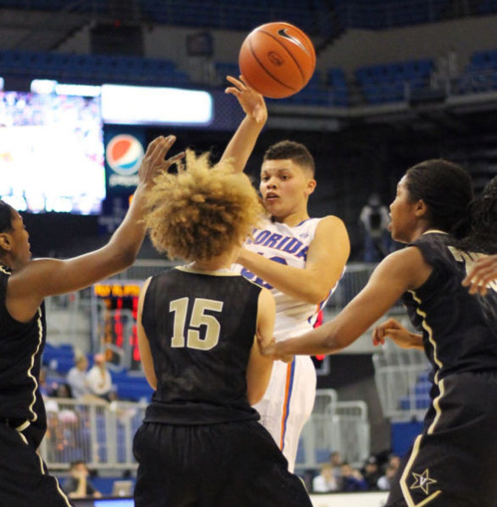 """<p align=""""justify"""">Sydney Moss (40) attempts a pass during Florida's 68-57 loss to Vanderbilt on Thursday in the O'Connell Center. Moss notched her third career double-double in Florida's 67-56 loss at South Carolina on Sunday.&nbsp;</p>"""