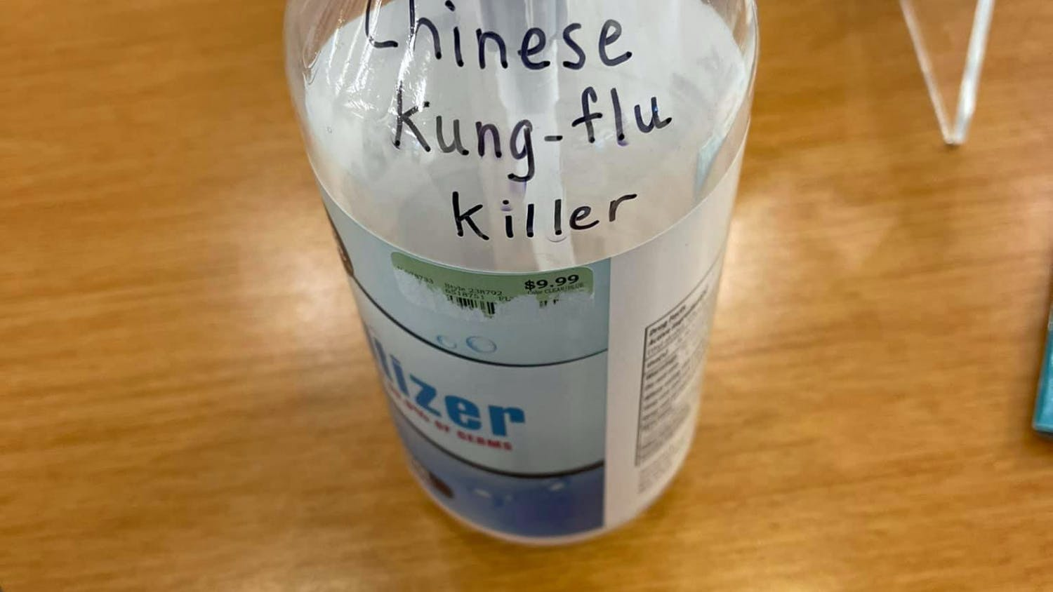 """Gainesville Nissan customer Larry Katz found a sanitizer bottle with the racist message, """"Chinese Kung-flu Killer"""" written in black ink in the dealership storeroom. [Photo courtesy of Larry Katz.]"""