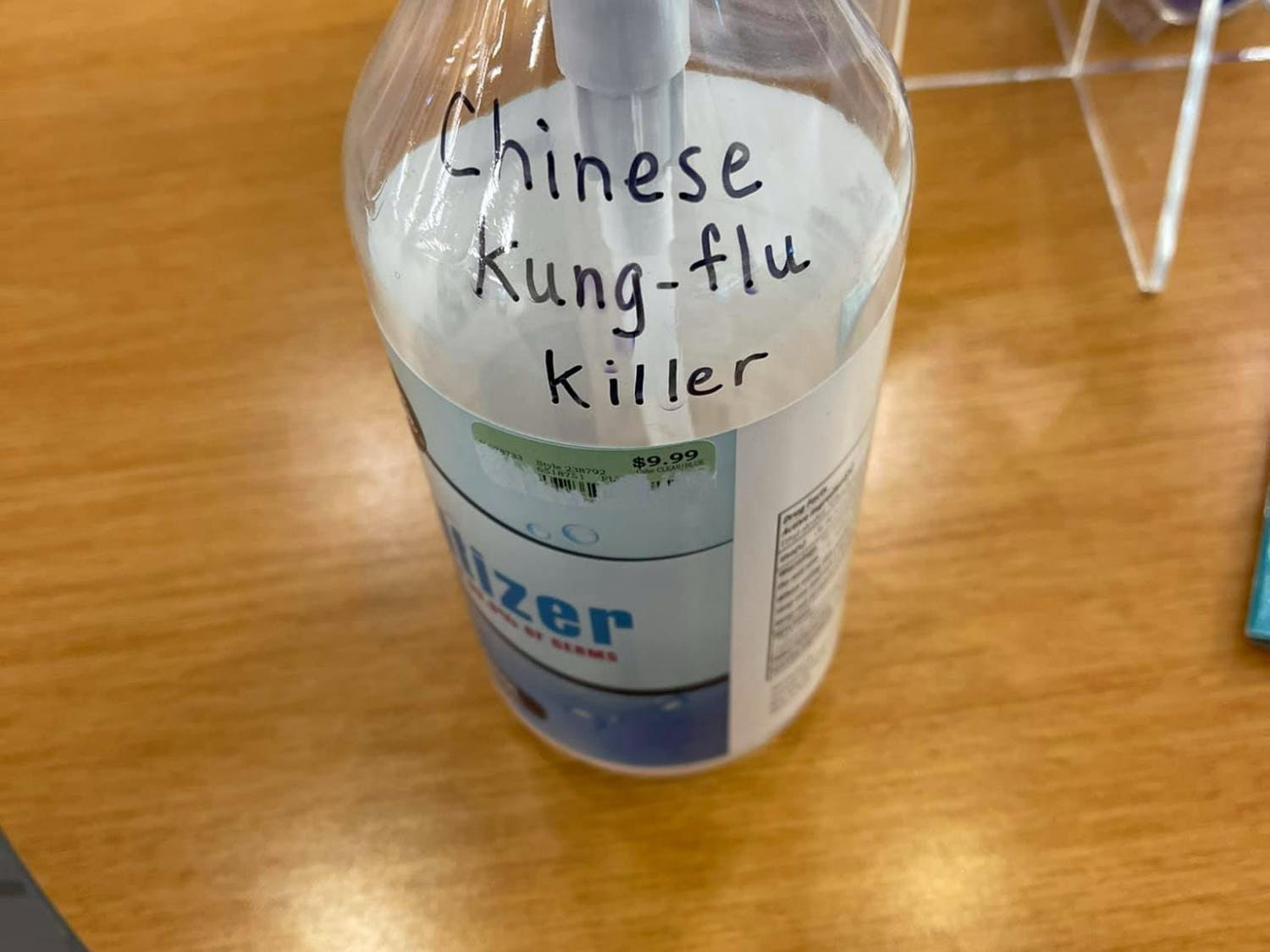 "Gainesville Nissan customer Larry Katz found a sanitizer bottle with the racist message, ""Chinese Kung-flu Killer"" written in black ink in the dealership storeroom. [Photo courtesy of Larry Katz.]"