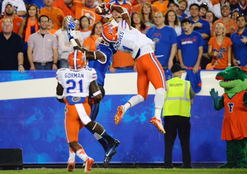 """<p align=""""justify"""">Vernon Hargreaves III intercepts a pass in the end zone during Florida's 24-7 victory on Sept. 28, 2013, at Commonwealth Stadium in Lexington, Ky.</p>"""