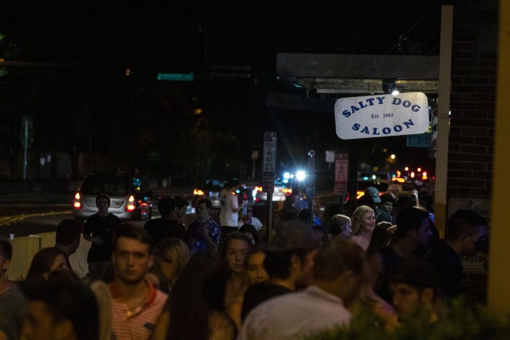 <p>More than 50 people are seen waiting outside next to Salty Dog Saloon and Fat Daddy's, located at Midtown off of West University Avenue, in Gainesville on Saturday night, after the first home football game. (Zachariah Chou/Alligator Staff)</p>