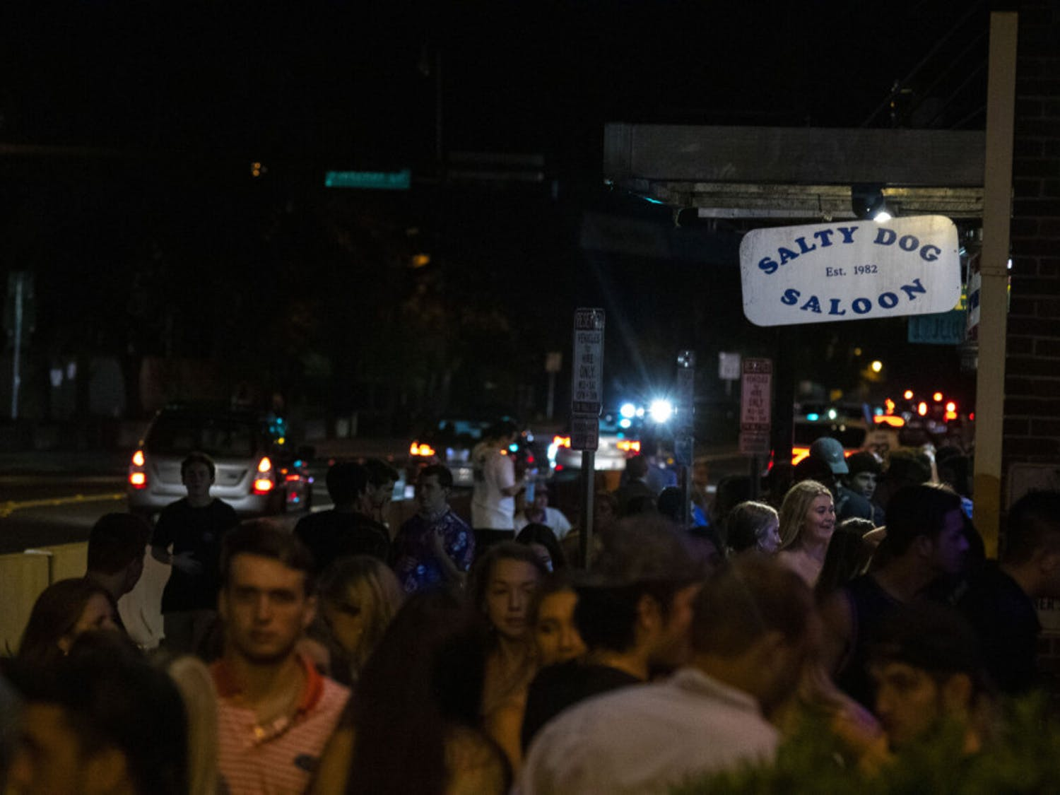 More than 50 people are seen waiting outside next to Salty Dog Saloon and Fat Daddy's, located at Midtown off of West University Avenue, in Gainesville on Saturday night, after the first home football game. (Zachariah Chou/Alligator Staff)
