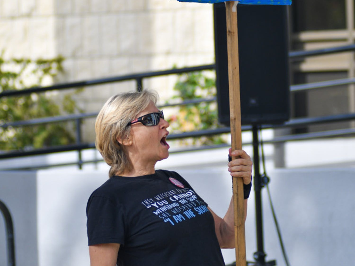"Janet Suggs, a 59-year-old Gainesville residents chants ""Count Every Vote"" outside city hall Sunday afternoon. About 50 people attended the Count Every Vote rally which was hosted by Our Revolution North Central Florida in order to support the Supervisors of elections as well as gain volunteers to assist with the recount."
