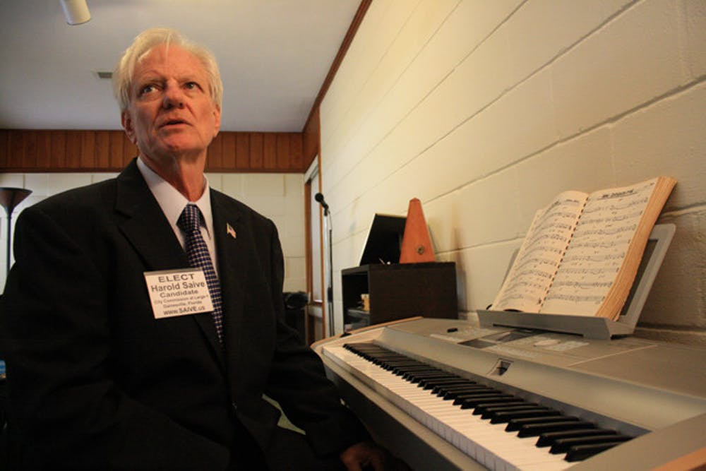 """<p>City Commission candidate Harold Saive works on a song for Occupy Gainesville in his study. The song, written by Duane Schwingel, another Occupy Gainesville protester, debuted on Saive's YouTube channel GainesvilleNews. """"It's in the embryonic stages right now,"""" Saive said.</p>"""