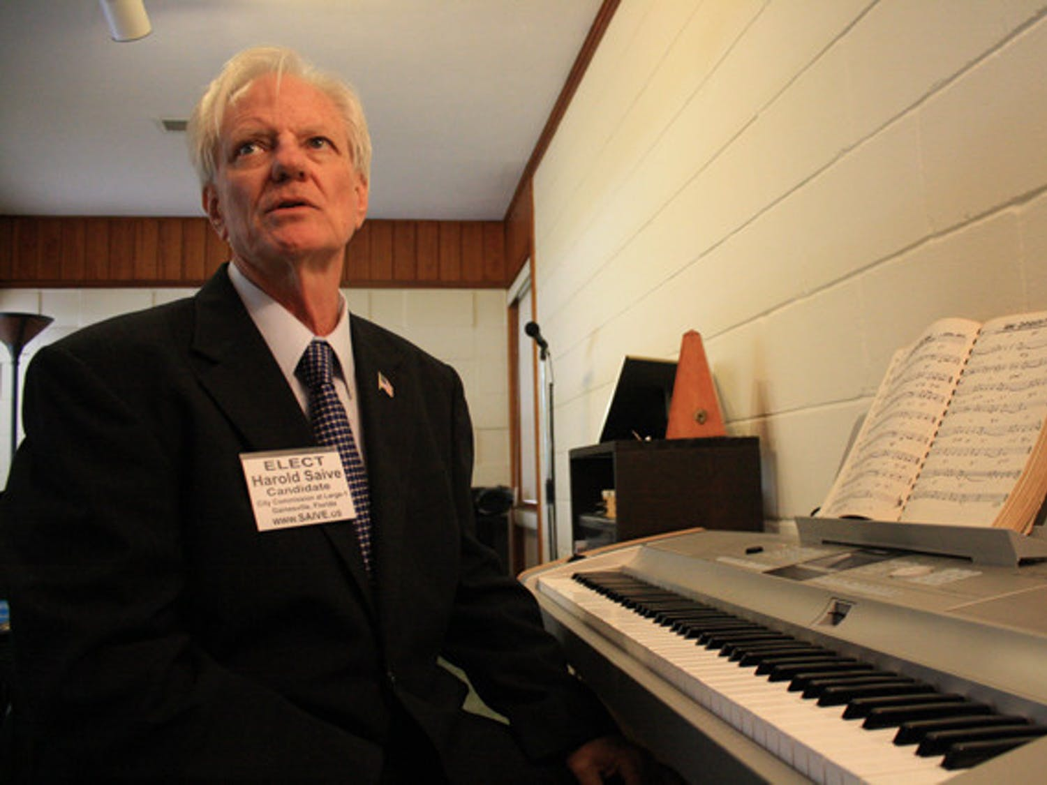 "City Commission candidate Harold Saive works on a song for Occupy Gainesville in his study. The song, written by Duane Schwingel, another Occupy Gainesville protester, debuted on Saive's YouTube channel GainesvilleNews. ""It's in the embryonic stages right now,"" Saive said."