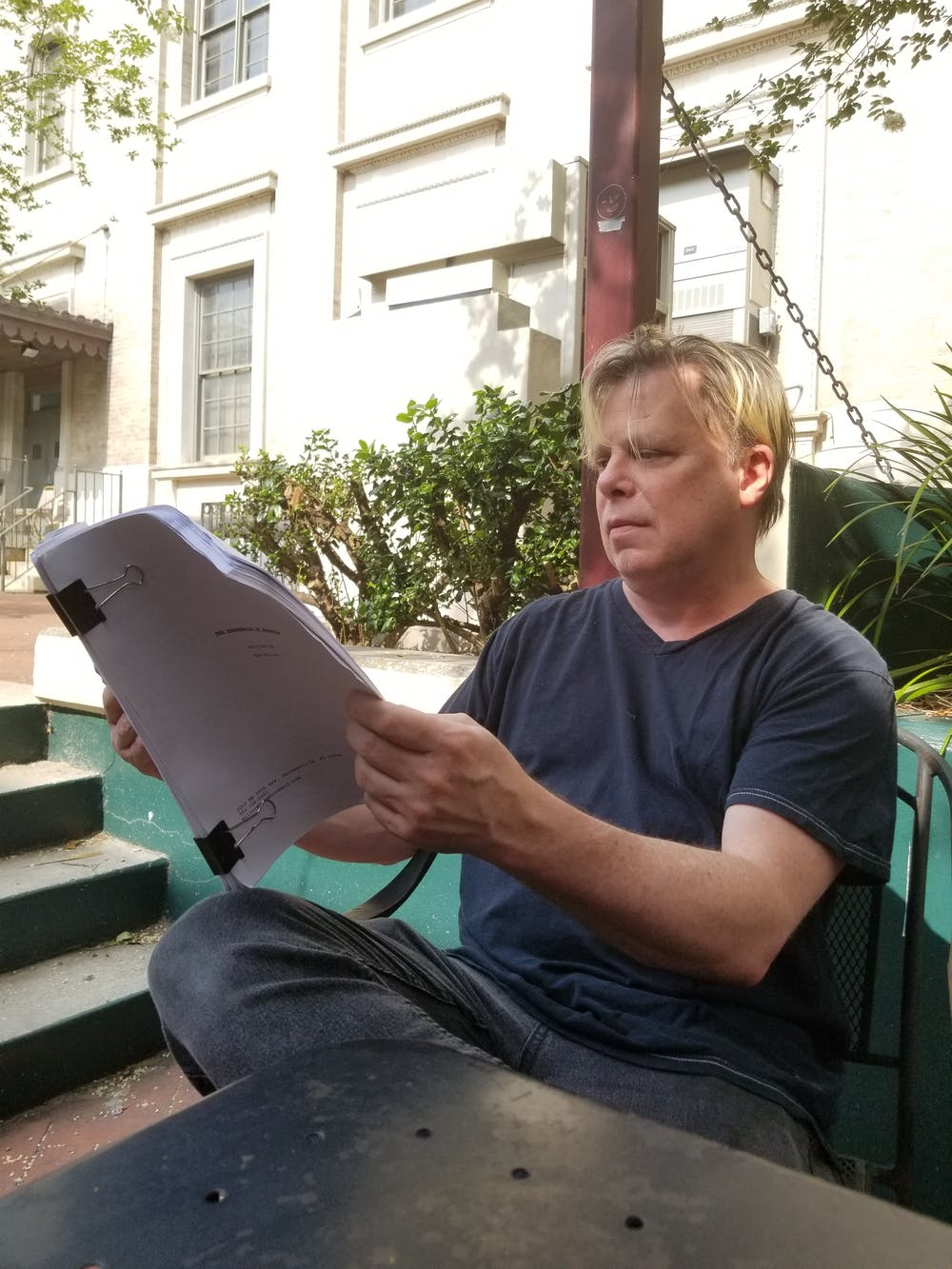 """<p><span>Writer and Gainesville resident Tom Miller looks over his most recent work """"The Tabernacle Hedonism.""""</span></p>"""