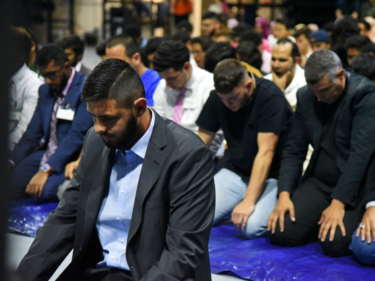 Eesaa Razzaq, an 18-year-old UF business administration freshman prays Thursday night at the Fast-A-Thon event at Stephen O'Connell Center.The event was hosted by Islam on Campus and designed to raise money for Gators for Refugee Medical Relief, a local charity dedicated to helping refugees locally and abroad, and NuDay Syria, a non-profit organization focused on bringing humanitarian aid to Syria.