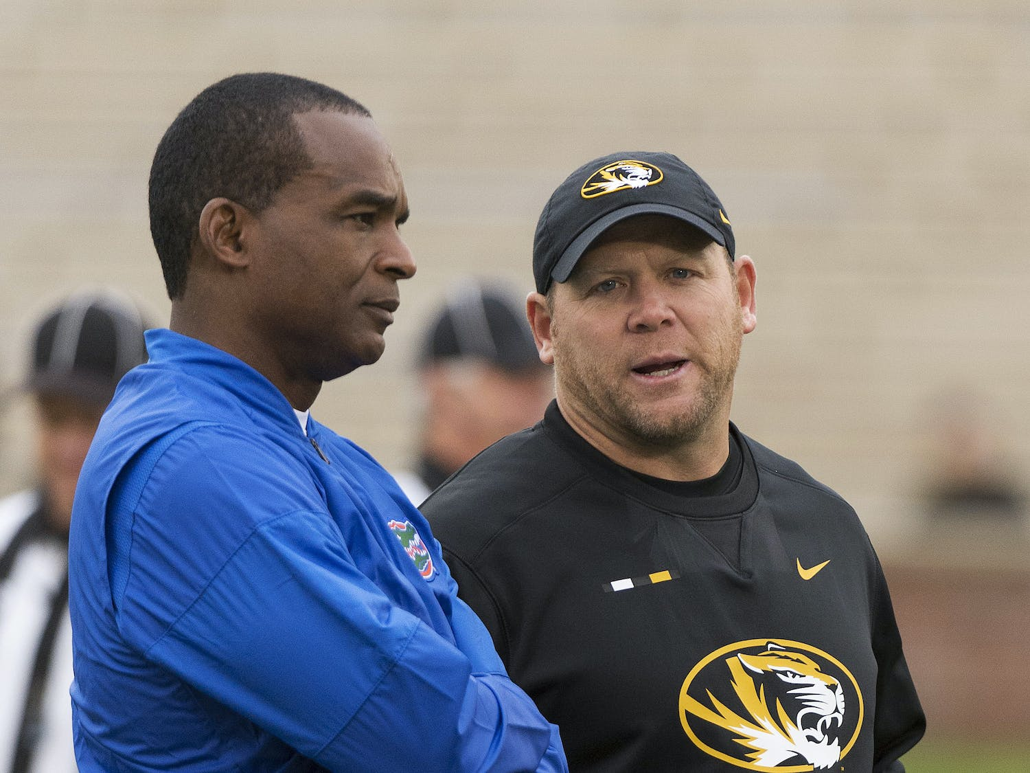 Missouri head coach Barry Odom, right, talks with Florida head coach Randy Shannon, left, before the start of an NCAA college football game Saturday, Nov. 4, 2017, in Columbia, Mo. (AP Photo/L.G. Patterson)