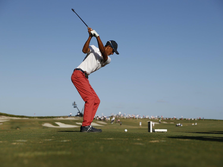 Ricky Castillo tees off from the 13th hole of the Seminole Golf Club Sunday. (Chris Keane/USGA)
