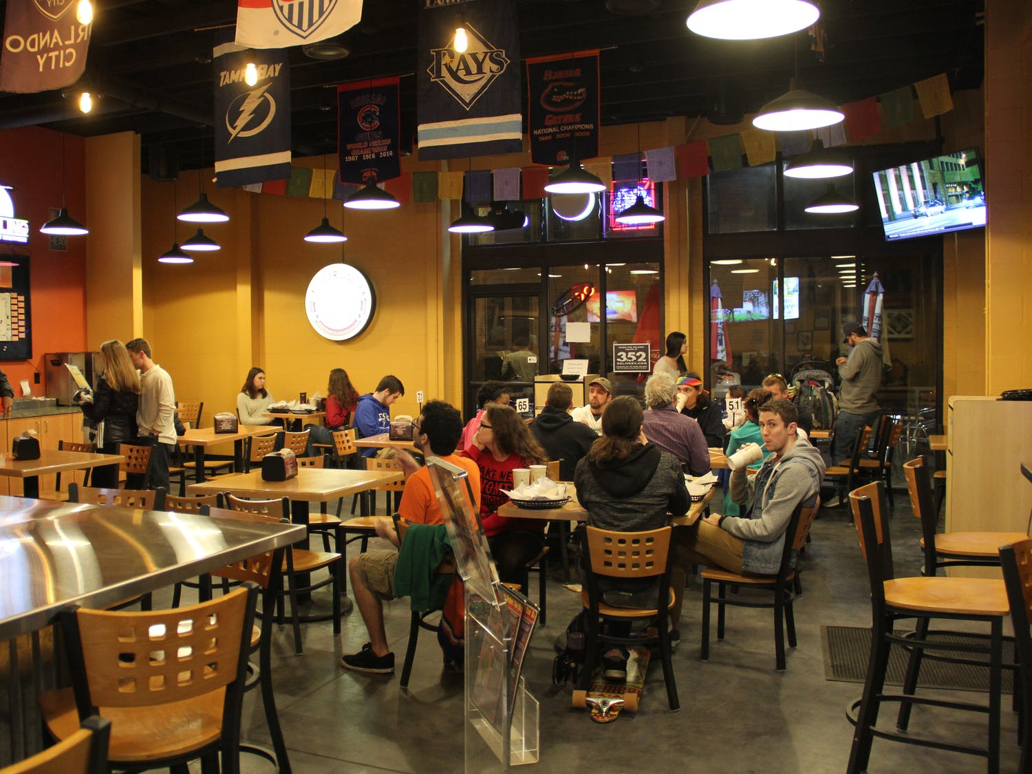 About 25 customers dine at Burrito Bros. Taco Co., located at 1402 W. University Ave., on Sunday night. The restaurant has been serving the Gainesville community since 1976.