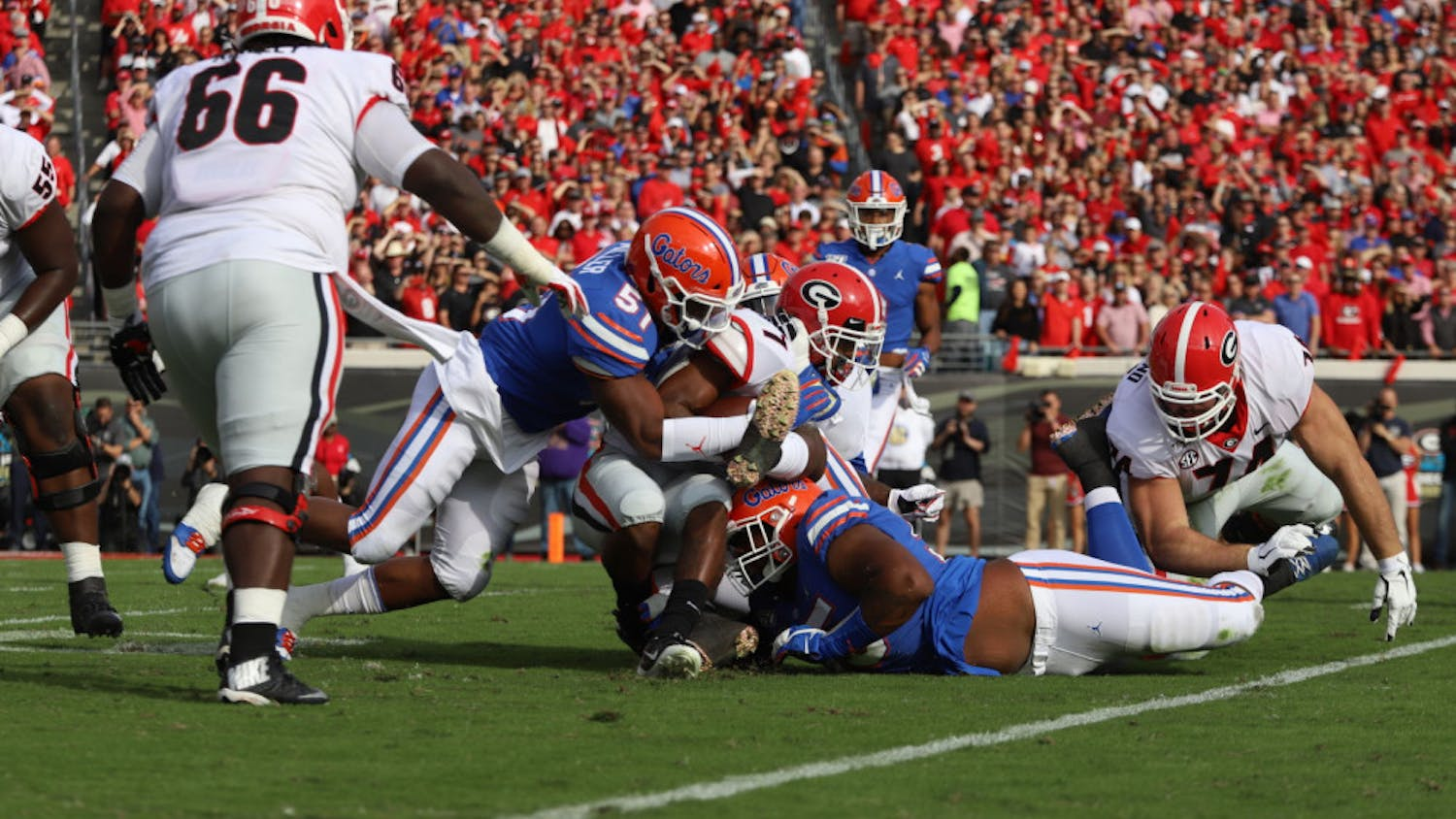 Linebacker Ventrell Miller and his teammates tackle a Georgia ball carrier.