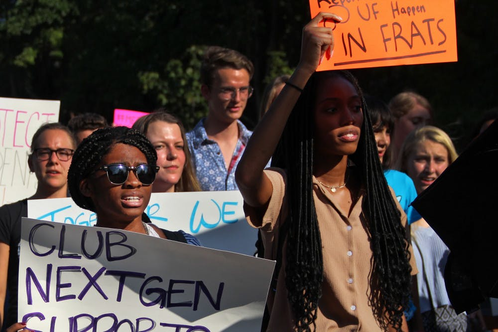"""<p dir=""""ltr""""><span>Yveline Saint Louis, a 19-year-old UF microbiology sophomore, and Torri McFarlane, a 19-year-old UF public relations sophomore, march down Fraternity Drive Tuesday afternoon during the protest for blue lights.</span></p>"""