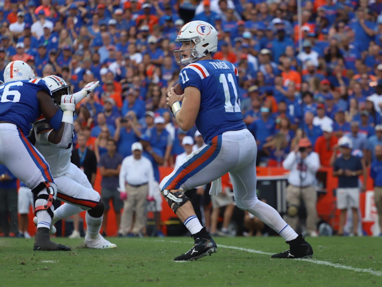 Kyle Trask drops back to pass and scans the field during the Gators' 24-13 win over Auburn last season. Florida's 10-game, conference-only schedule begins on Sept. 26 against Ole Miss.