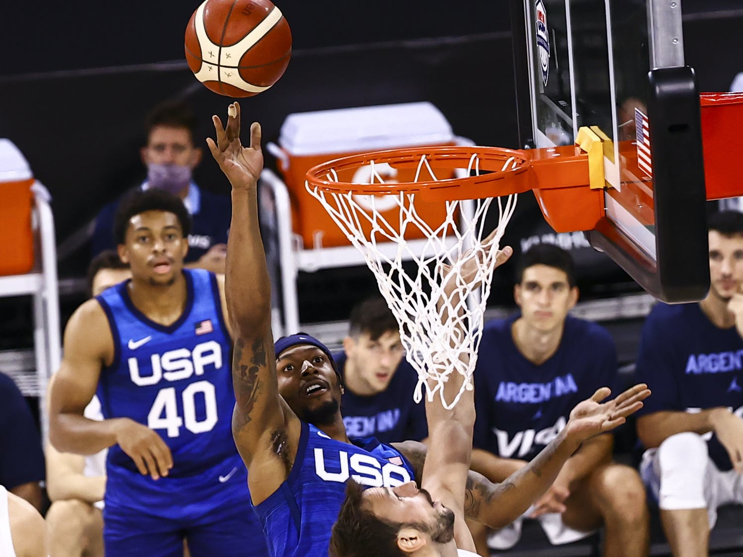 United States' Bradley Beal shoots around Argentina's Marcos Delia during the second half of an exhibition basketball game in Las Vegas on Tuesday, July 13, 2021. (Chase Stevens/Las Vegas Review-Journal via AP)