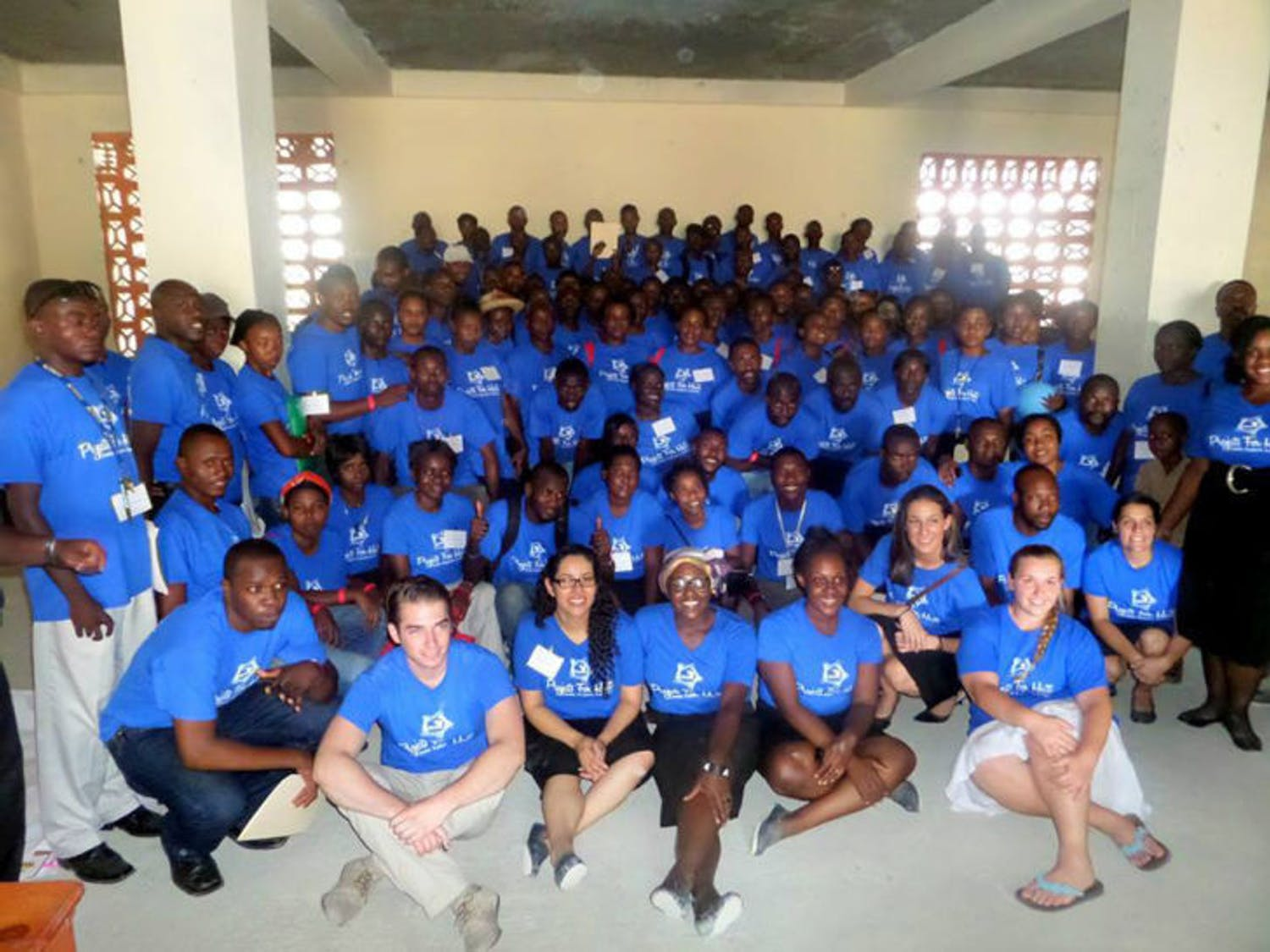 Pictured are 135 teachers from the conference held by Projects for Haiti. The event helps them network and improve teaching skills through workshops and training exercises.